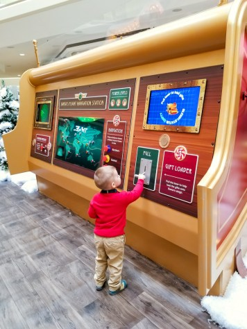 Toddler with santa flight controls